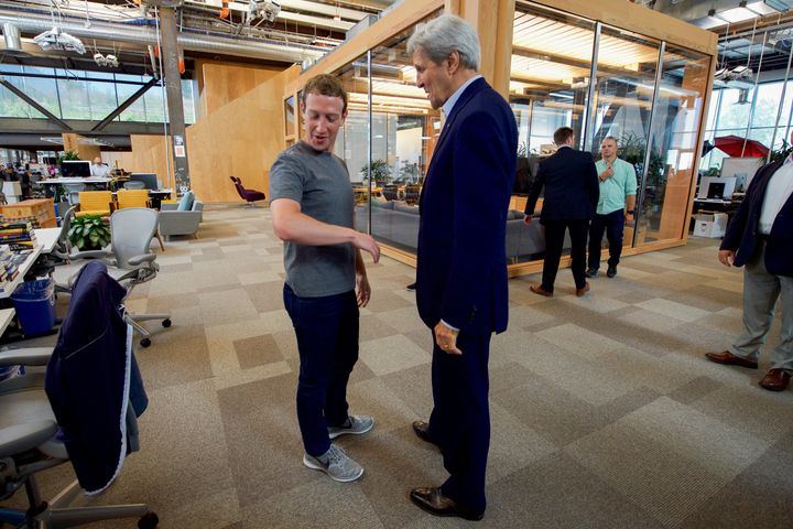 Former Secretary of State John Kerry speaks with Facebook CEO Mark Zuckerberg at Facebook headquarters in 2016 in M