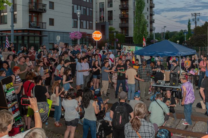 A loud cheer comes after the moments of silence at the end of the vigil at OccupyICEPDX, just in front of the ICE Portla