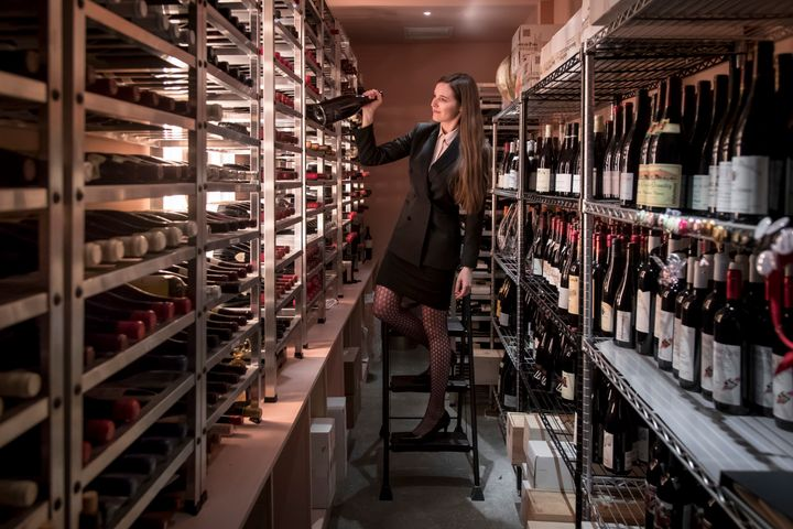 Victoria James picks bottles from the pink wine cellar at Cote.