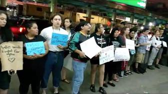 People are seen gathered outside of LaGuardia Airport in Queens New York