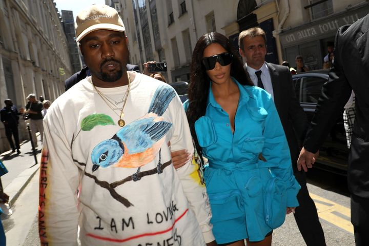 Kim Kardashian and Kanye West arrive at the Louis Vuitton Menswear Spring/Summer 2019 show on Thursday.