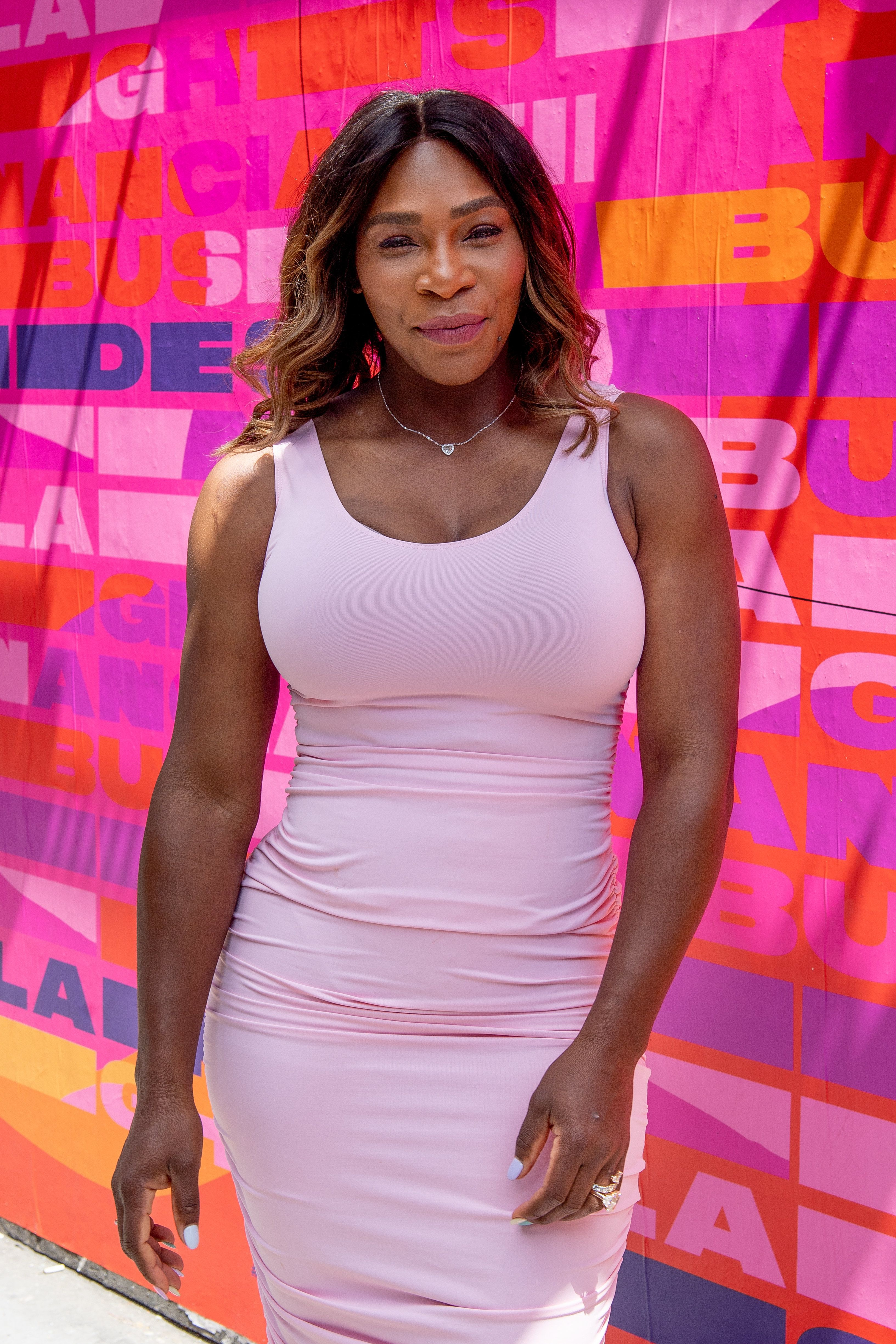 NEW YORK, NY - JUNE 20:  Serena Williams stands next to Isabel Castillo Guijarro's mural during the Allstate foundation Purple Purse and Serena Williams launch national street art campaign to raise domestic violence awareness on June 20, 2018 in New York City.  (Photo by Roy Rochlin/Getty Images)