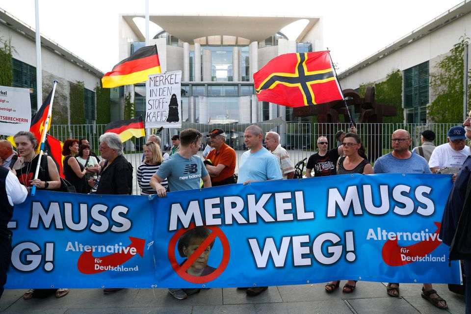 Supporters of the Alternative for Germany (AfD) party stage a protest in Berlin with signs reading