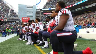 SEATTLE, WA - OCTOBER 29:  Members of the Houston Texans kneel during the national anthem before the game against the Seattle Seahawks at CenturyLink Field on October 29, 2017 in Seattle, Washington. During a meeting of NFL owners earlier in October, Houston Texans owner Bob McNair said 'we can't have the inmates running the prison,' referring to player demonstrations during the national anthem. (Photo by Jonathan Ferrey/Getty Images)