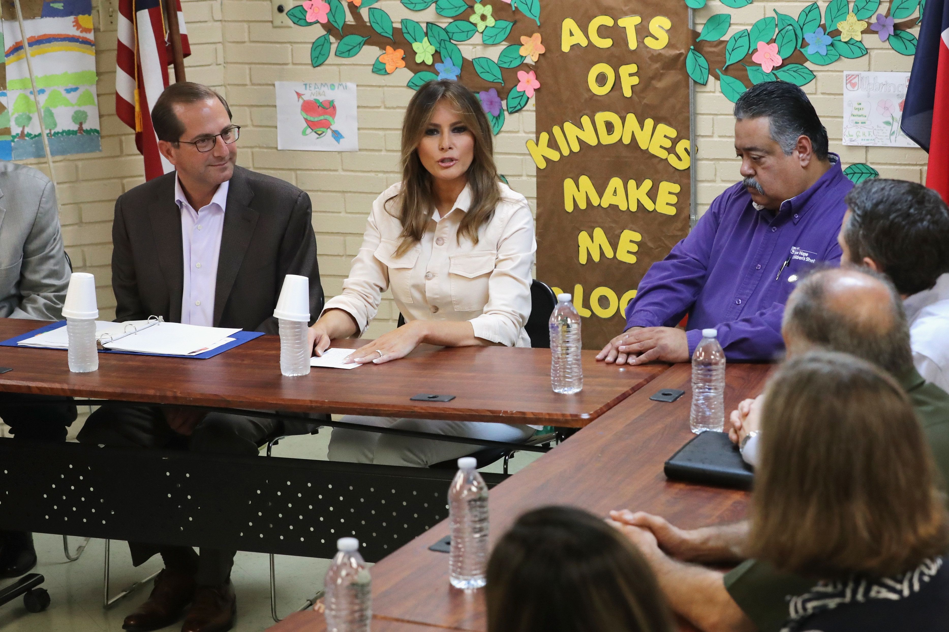 MCALLEN, TX - JUNE 21:  U.S. first lady Melania Trump participates in a round table discussion alongside HHS Secretary Alex Azar (L) and program director Rogelio de la Cerda Jr. (R), with doctors and social workers at the Upbring New Hope Childrens Center operated by Lutheran Social Services of the South and contracted with the Department of Health and Human Services June 21, 2018 in McAllen, Texas. The first lady traveled to Texas to see first hand the condition and treatment that migrant children taken from their families at the U.S.-Mexico border are receiving from the federal government. Following public outcry and criticism from members of his own party, President Donald Trump signed an executive order Wednesday to stop the separation of migrant children from their families, a practice the administration employed to deter illegal immigration at the border.  (Photo by Chip Somodevilla/Getty Images)