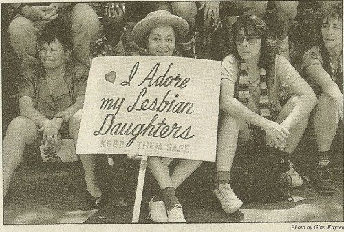 Frances Goldin holds her sign at an early Pride