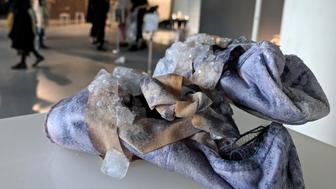 Sweat crystals grow on a pair of ballet shoes, as part of a collection by Alice Potts that imagines a future where accessories are grown from our bodily excretions, in the Royal College of Art Fashion Show in London, Britain, June 14, 2018. Picture taken June 14, 2018. REUTERS/Stuart McDill