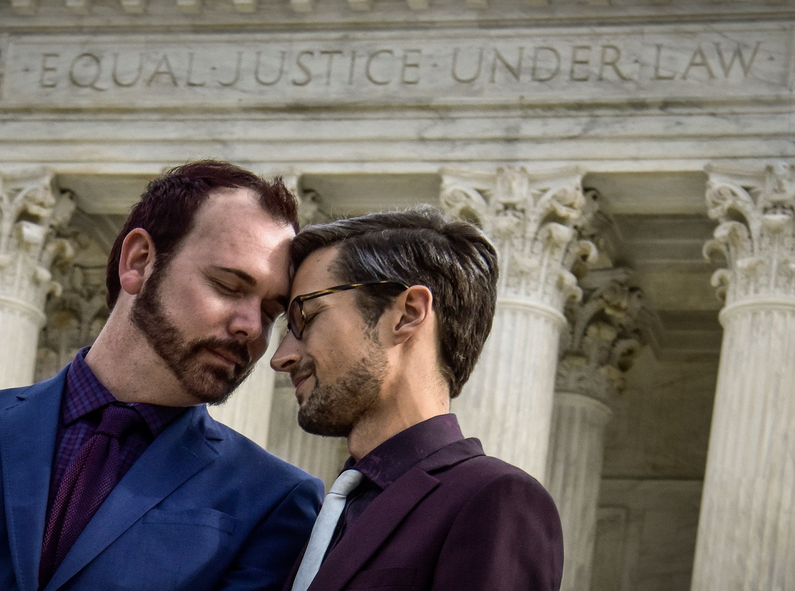 WASHINGTON, DC - DECEMBER 5: Plaintiffs Charlie Craig, left, and David Mullins out in front of the Supreme court, which heard arguments in the Masterpiece Bakery discrimination case on December, 05, 2017 in Washington, DC. (Photo by Bill O'Leary/The Washington Post via Getty Images)