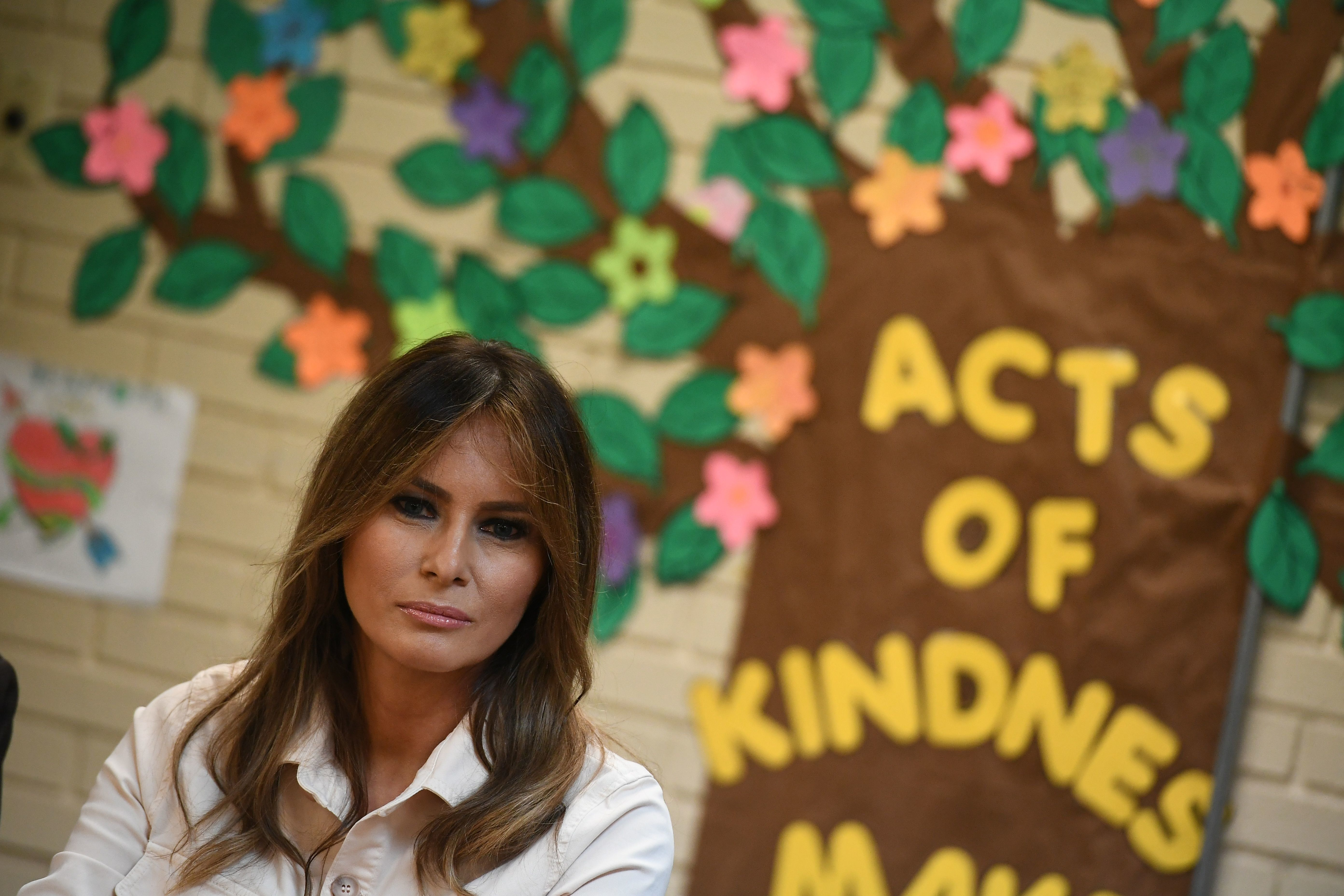 TOPSHOT - US First Lady Melania Trump takes part in a roundtable discussion at Luthern Social Services of the South's Upbring New Hope Children Center in McAllen, Texas on June 21, 2018. - First Lady Melania Trump made a surprise visit to the US-Mexican border on Thursday, June 21, 2018 as her husband's administration seeks to quell a firestorm over migrant family separations. President Donald Trump first announced the trip by his wife, who will tour a non-profit social services center for migrant children, as well as a customs and border patrol processing center, according to a statement from her office. (Photo by MANDEL NGAN / AFP)        (Photo credit should read MANDEL NGAN/AFP/Getty Images)