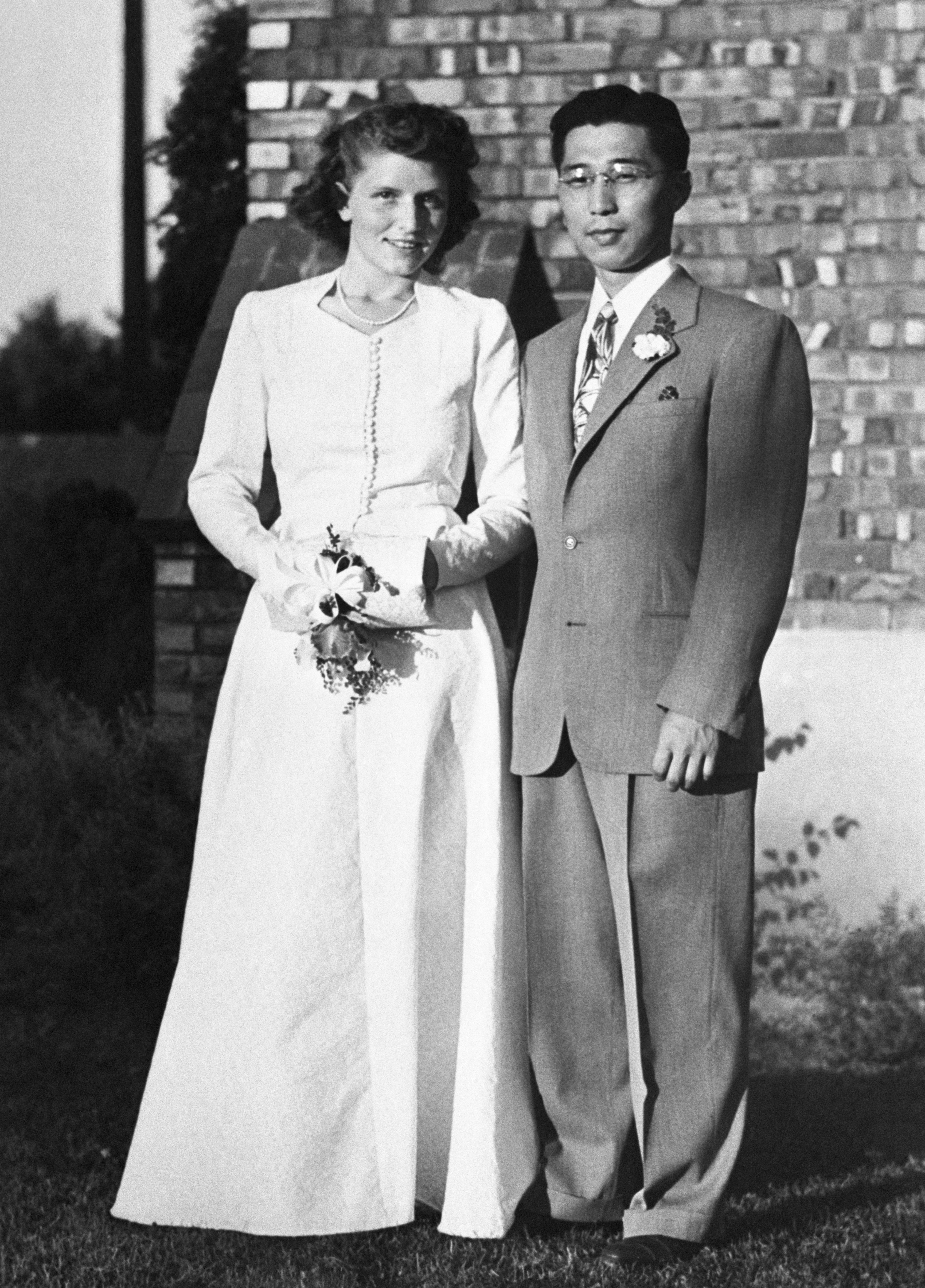 Gordon K. Hirabayashi and his bride, Esther Schmoe, after their Quaker wedding ceremony in Spokane, Washington. Both were stu