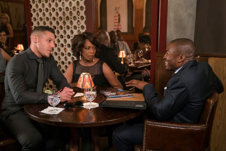 Mariah Dillard (Alfre Woodard) sits alongside her love interest and crime partner, Shades (Theo Rossi).