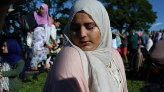 A Muslim woman prays at Bensonhurst Park to celebrate Eid Al-Fitr in the Brooklyn, New York, U.S., June 15, 2018. REUTERS/Gabriela Bhaskar