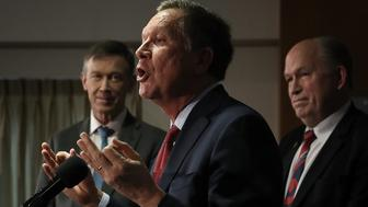 WASHINGTON, DC - FEBRUARY 23:  Gov. John Kasich (C) (R-OH), Gov. John Hickenlooper (L) (D-CO), and Gov. Bill Walker (R) (I-AK) speak during a press conference February 23, 2018 in Washington, DC. The three governors unveiled a blueprint for improved health care in the U.S. during the press conference. (Photo by Win McNamee/Getty Images)