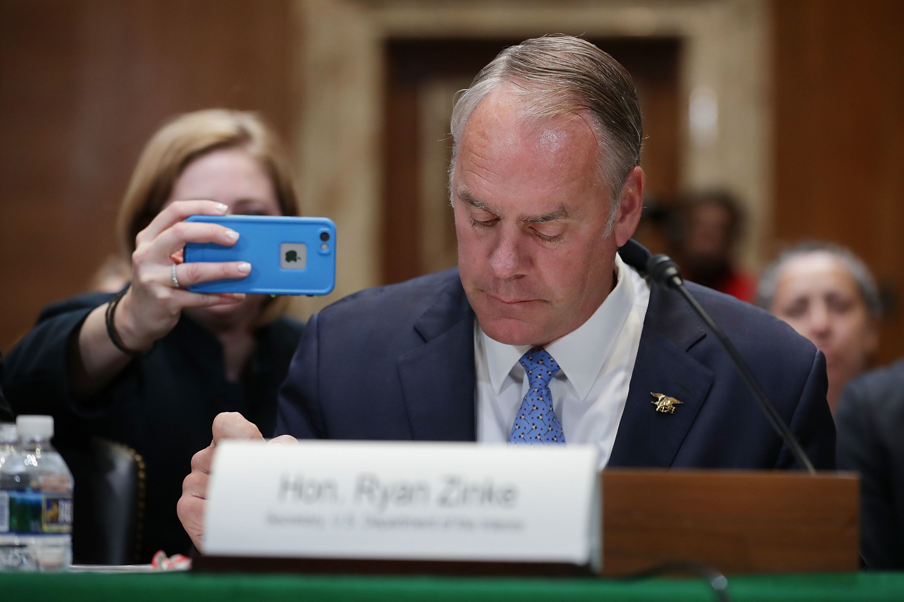 WASHINGTON, DC - MAY 10:  An aide to U.S. Interior Secretary Ryan Zinke makes a photograph for his Twitter account as he testifies before the Senate Appropriations Committee's Interior, Environment, and Related Agencies Subcommittee in the Dirksen Senate Office Building on Capitol Hill May 10, 2018 in Washington, DC. Zinke testified about his department's FY2019 funding request and budget.  (Photo by Chip Somodevilla/Getty Images)