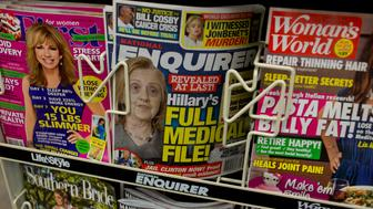 FLORENCE, SC - SEPTEMBER 14: The National Enquirer repeats an allegation of Donald Trump's that Hillary Clinton is not healthy enough for the job of President by using a doctored photograph of her on its cover as seen in a Florence, South Carolina supermarket on September 14, 2016. (Photo by Andrew Lichtenstein/ Corbis via Getty Images)