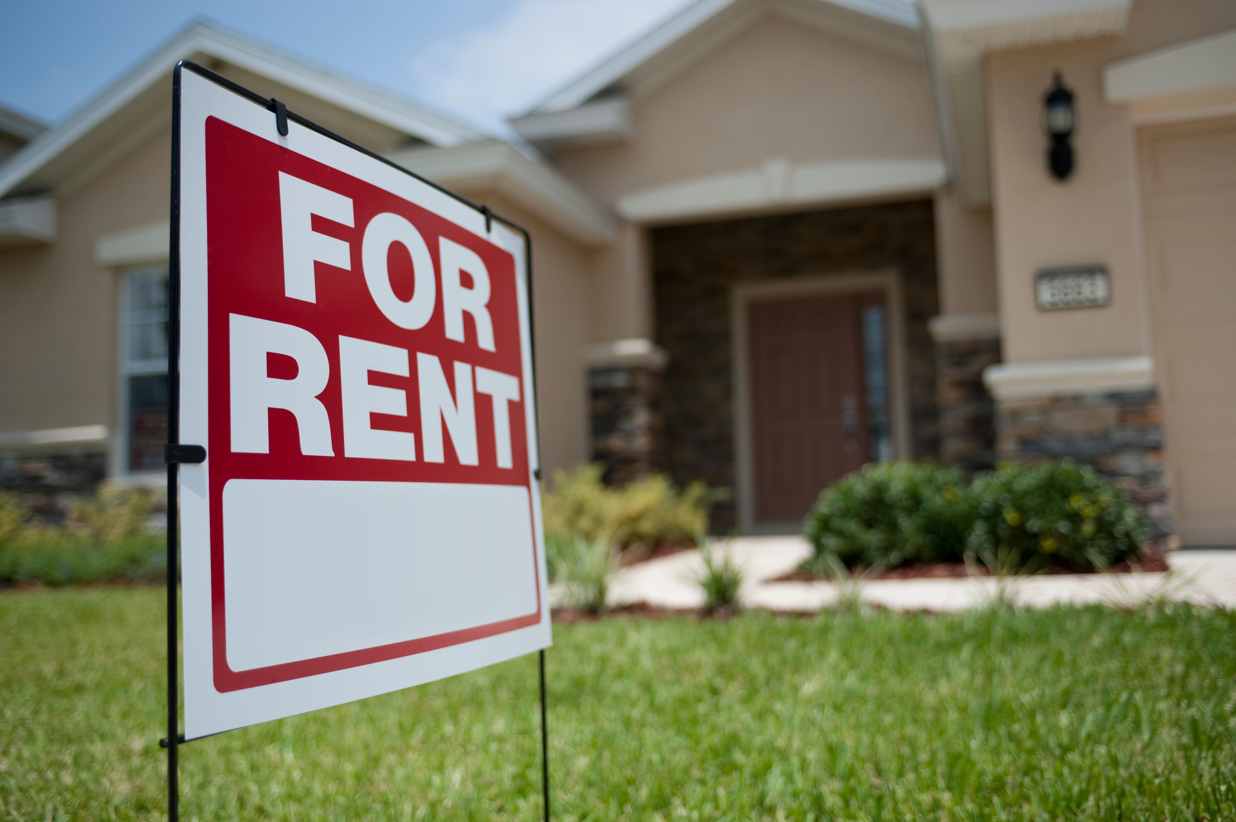 For Rent sign in front of new house