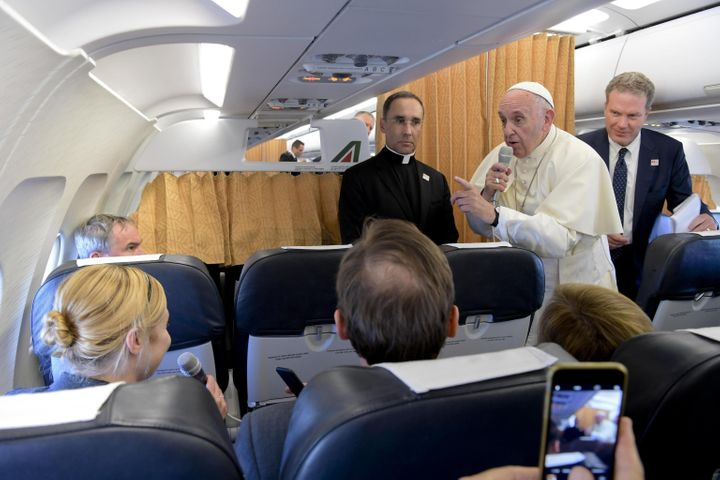 Pope Francis talks with journalists aboard a plane, at the end of his visit to Geneva on June 21.