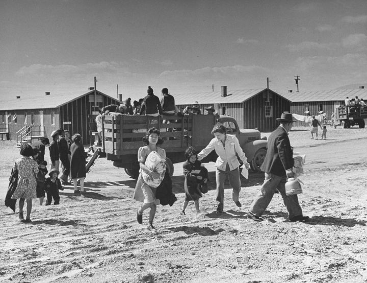 Japanese-American families arrive at Heart Mountain in Wyoming during World War II.