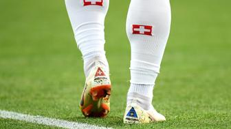 KALININGRAD, RUSSIA - JUNE 22:  The Kosovo flag is seen on Xherdan Shaqiri of Switzerland's boots during the 2018 FIFA World Cup Russia group E match between Serbia and Switzerland at Kaliningrad Stadium on June 22, 2018 in Kaliningrad, Russia.  (Photo by Matthias Hangst/Getty Images)