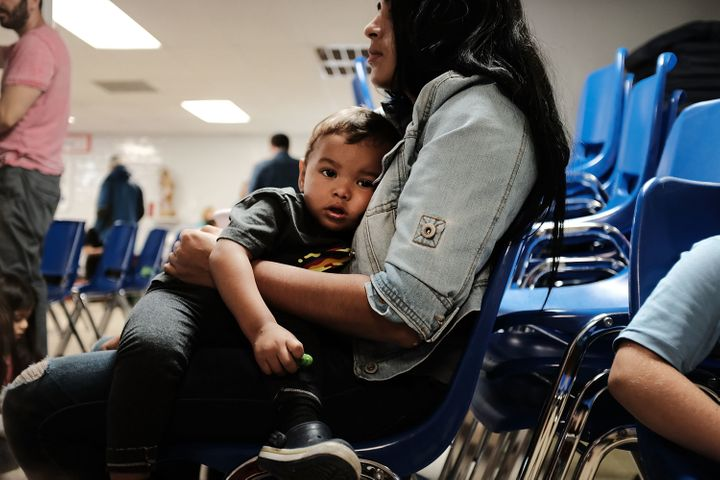 A woman who identified herself as Jennifer sits with her sonat the Catholic Charities Humanitarian Respite Center in Mc