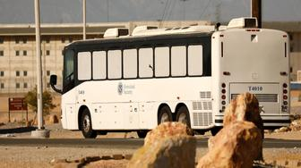 Immigration and Customs Enforcement (ICE) detainees arrive at FCI Victorville federal prison in Victorville, California, U.S. June 8, 2018. REUTERS/Patrick T. Fallon
