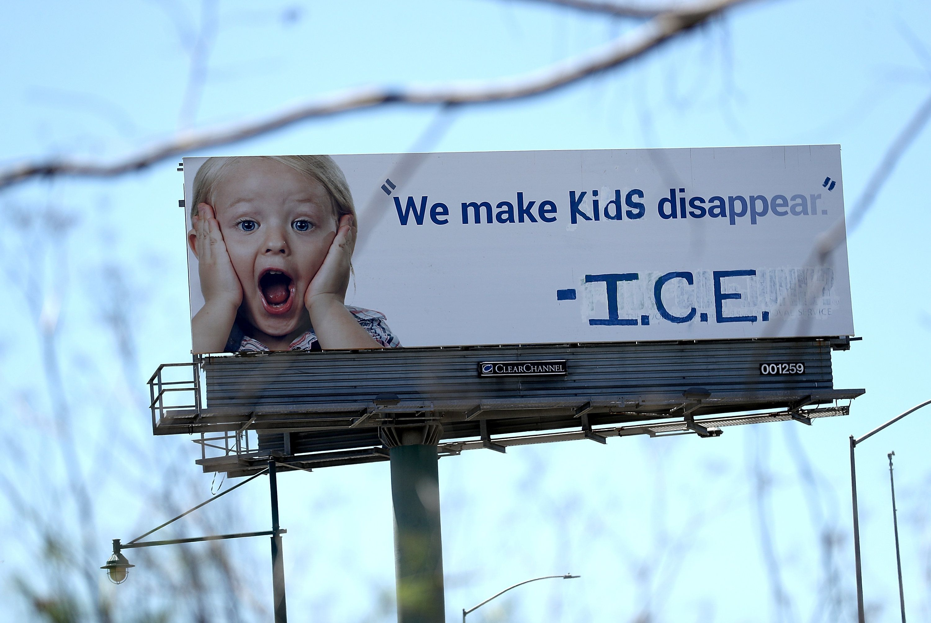 EMERYVILLE, CA - JUNE 21:  A vandalized 1-800-GOT-JUNK billboard shows a message in in protest with the Immigration and Customs Enforcement (ICE) and their participation in separating children from their parents trying to enter the U.S. from Mexico on June 21, 2018 in Emeryville, California. Activist group Indecline vandalized a billboard along Interstate 80 protesting the zero-tolerance policy by the Trump administration of separating children from their parents while the parents navigate the court system after being apprehended trying to enter the United States from Mexico.  (Photo by Justin Sullivan/Getty Images)