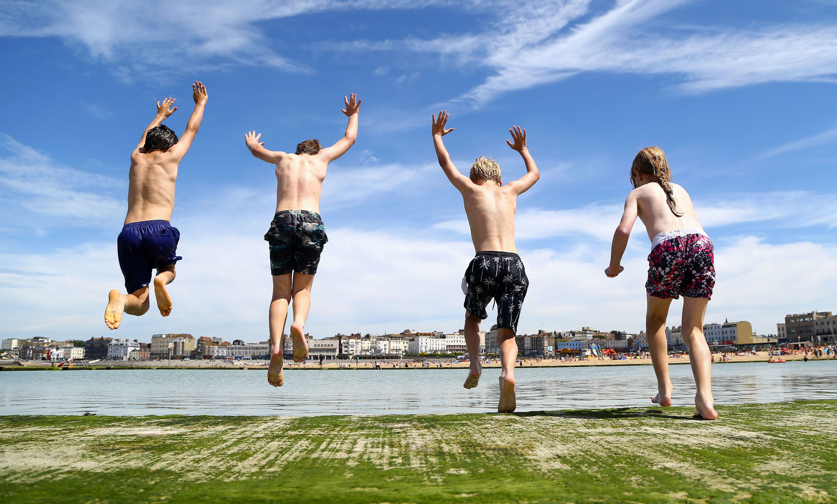 Children enjoy jumping into a sea pool in Margate,