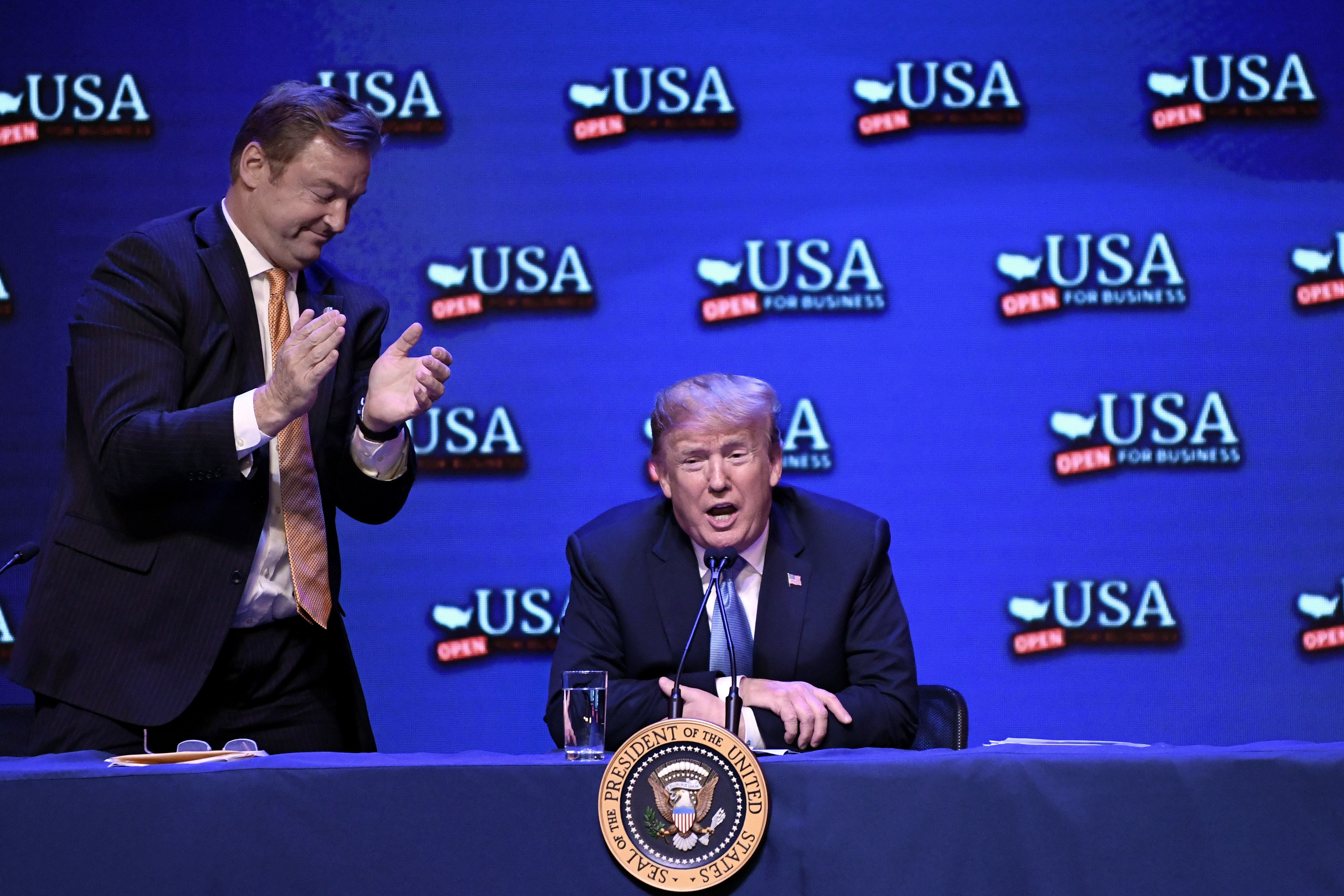 US President Donald Trump speaks as Nevada Senator Dean Heller (L) applauds during a roundtable discussion on tax reform at the South Point Hotel Casino and Spa in Las Vegas, Nevada, on June 23, 2018. (Photo by Olivier Douliery / AFP)        (Photo credit should read OLIVIER DOULIERY/AFP/Getty Images)