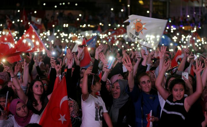 AK Party supporters celebrate in front of the AKP headquarters in Ankara, Turkey.