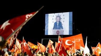 Turkish President Tayyip Erdogan is seen on the screen as he addresses his supporters in Istanbul, Turkey June 24, 2018. REUTERS/Alkis Konstantinidis