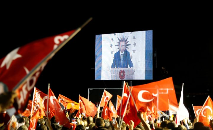 Turkish President Tayyip Erdogan is seen on the screen as he addresses his supporters in Istanbul, Turkey.