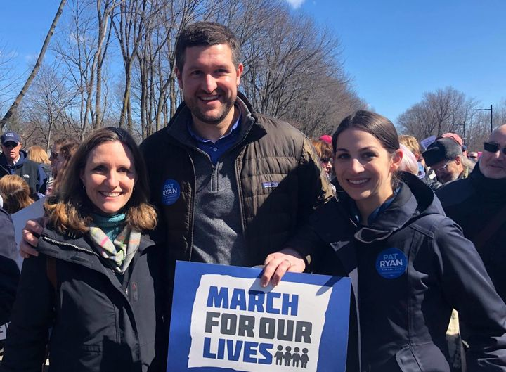 Democrat Pat Ryan, center, stands with his wife, Rebecca, right, and another attendee of a March for Our Lives rally in New Y