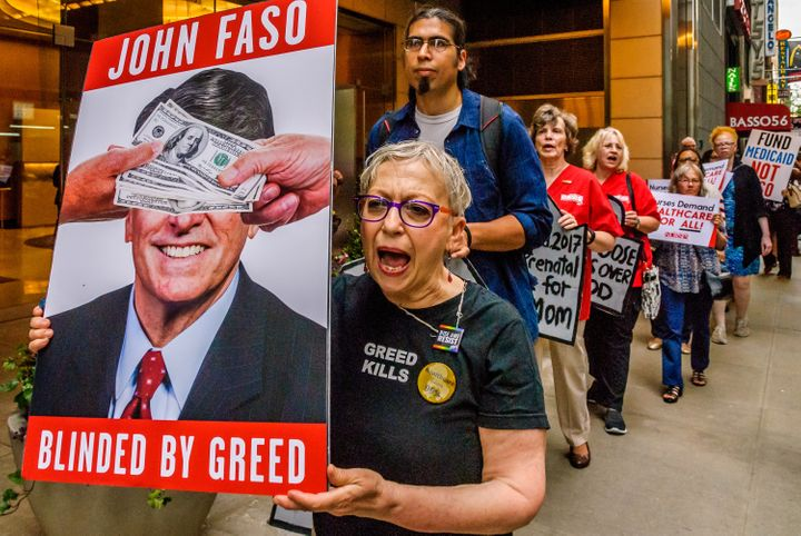 Residents of New York's 19th Congressional District protest outside a Manhattan fundraiser for Rep. John Faso (R) in July 201