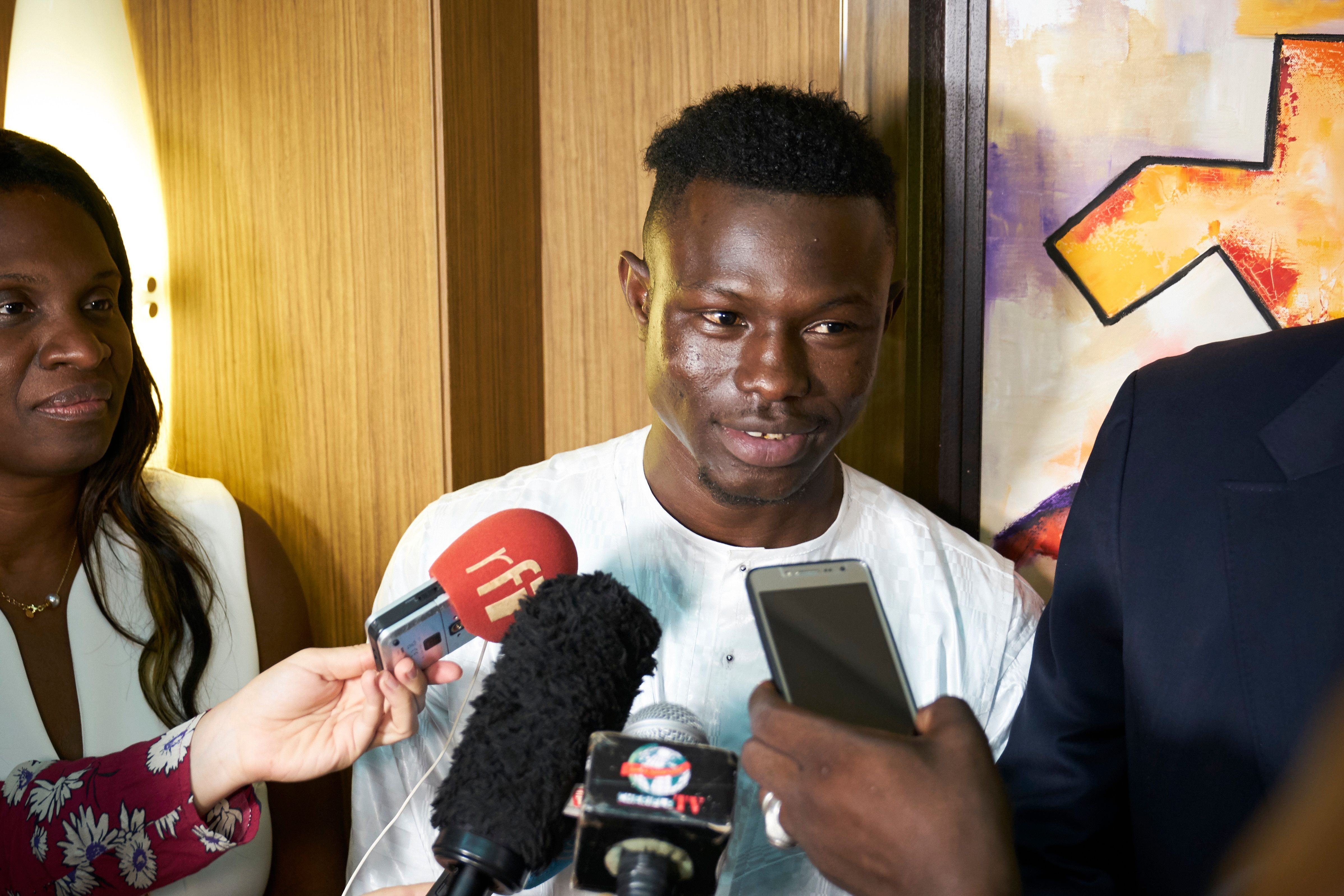 Mamoudou Gassama talks to media during a meeting with Mali's president on June 18.
