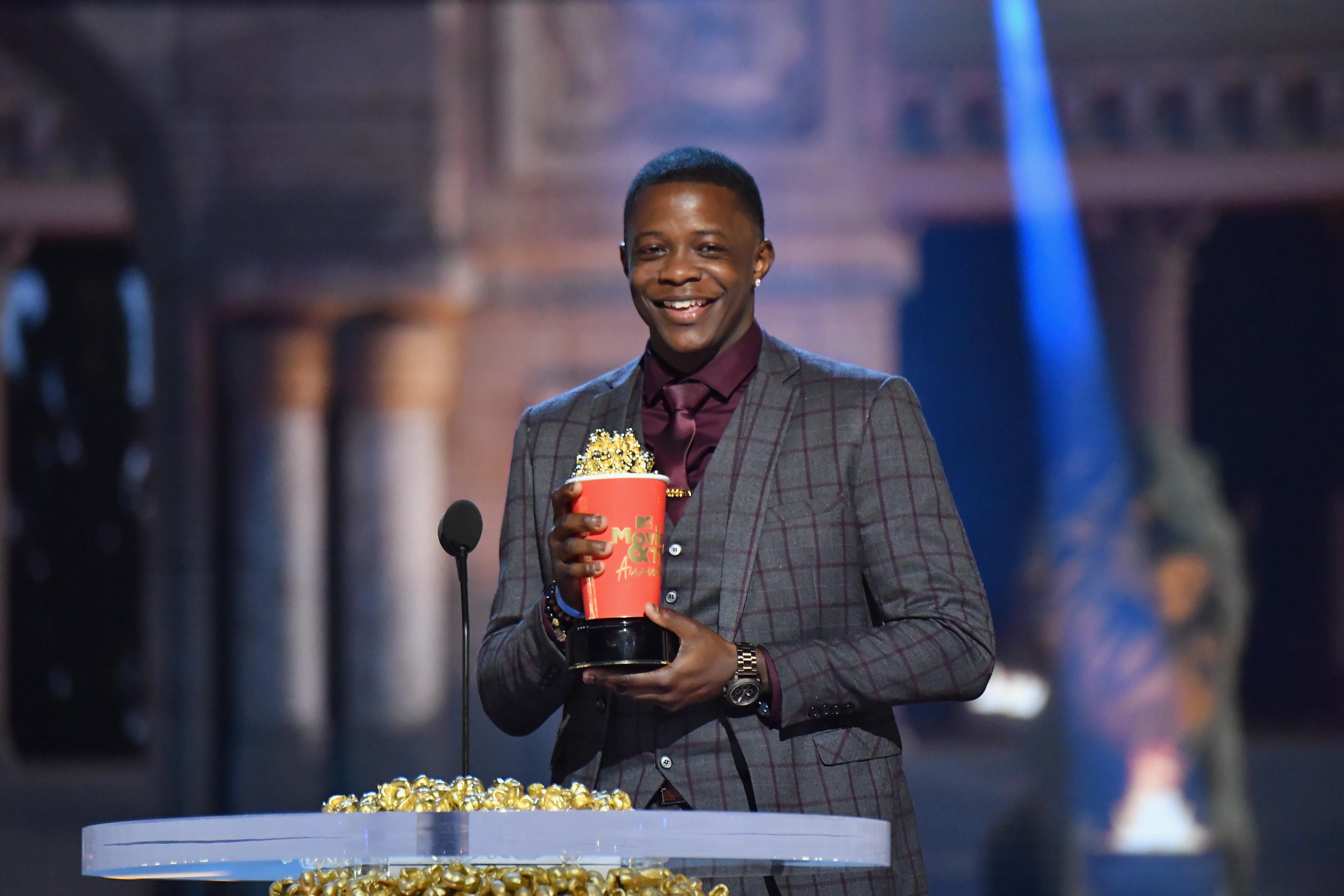 James Shaw Jr. accepts an award onstage at the MTV Movie & TV Awards June 16.