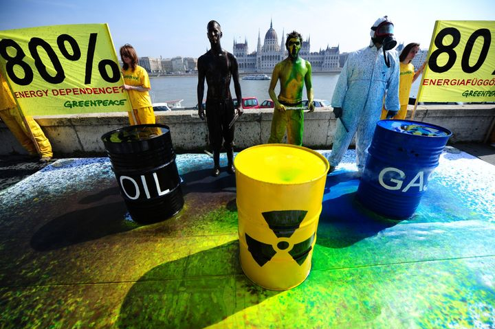 Greenpeace activists protest opposite theHungarian parliament building in Budapest in April 2014. After the government