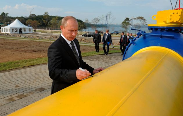 Russia's prime minister Vladimir Putin leaves his signature on a gas pipeline in Vladivostok, Russia,...