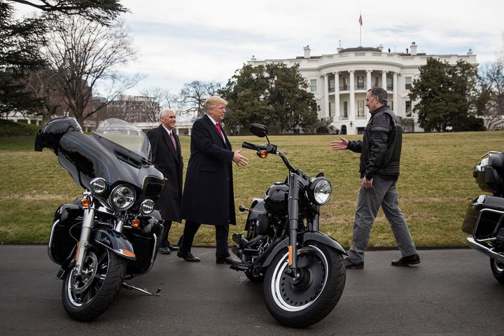 President Donald Trump (center) greets Matthew Levatich (right), CEO of Harley-Davidson Inc., outside the White House in Febr