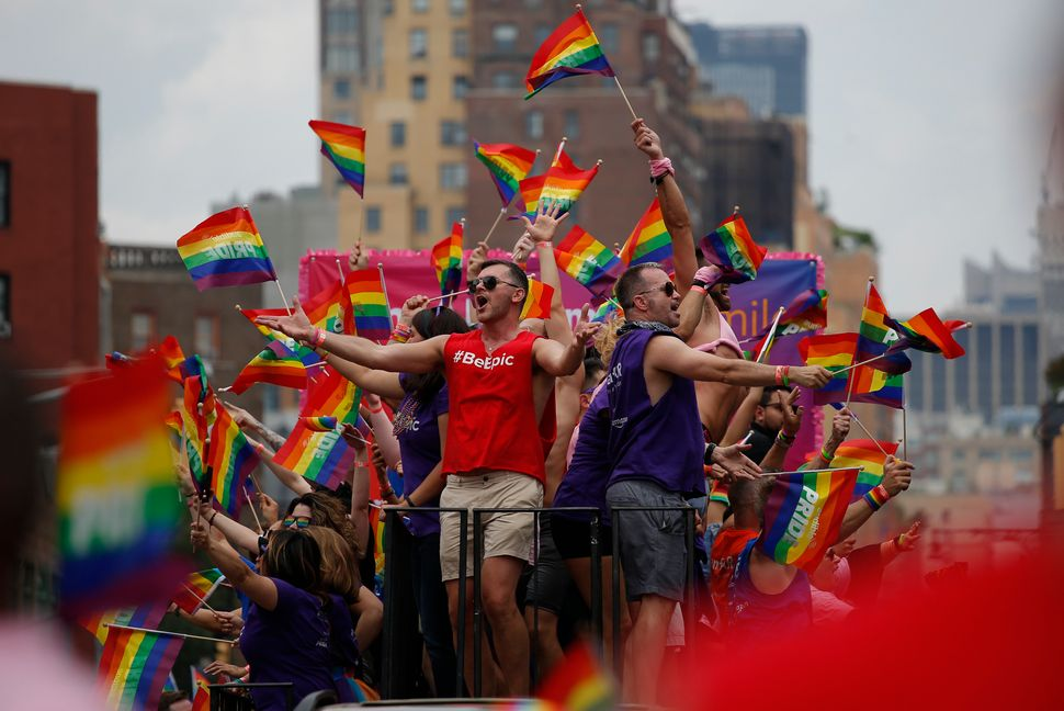 Revelers take part in the annual Pride parade.