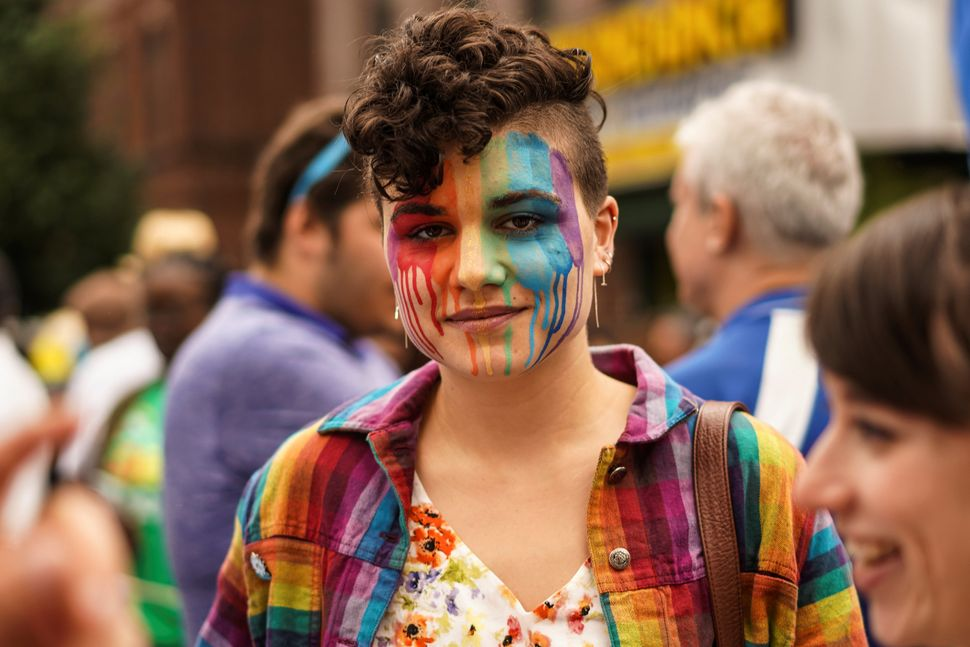 Joanne Norris poses for aphoto at the Pride parade in Queens.