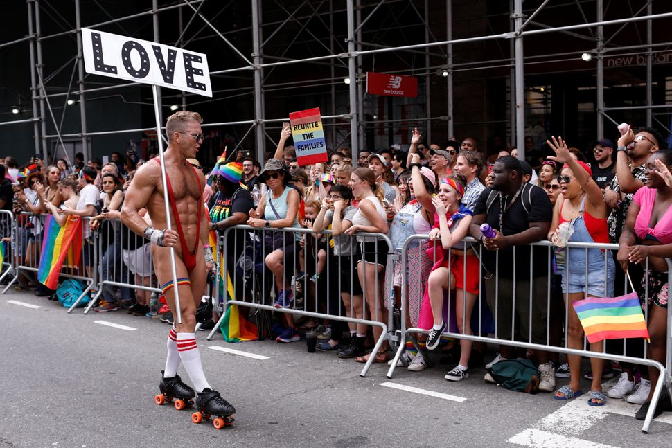 A person roller-skates in the Pride parade.