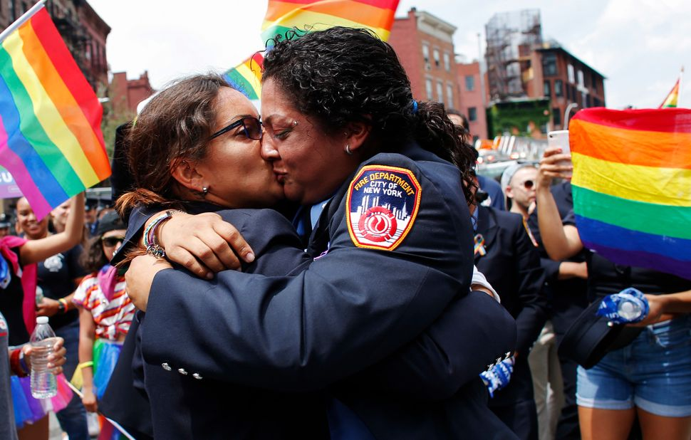 EMT Trudy Bermudez and paramedic Tayreen Bonilla of the New York City Fire Department get engaged at the annual Pride parade.