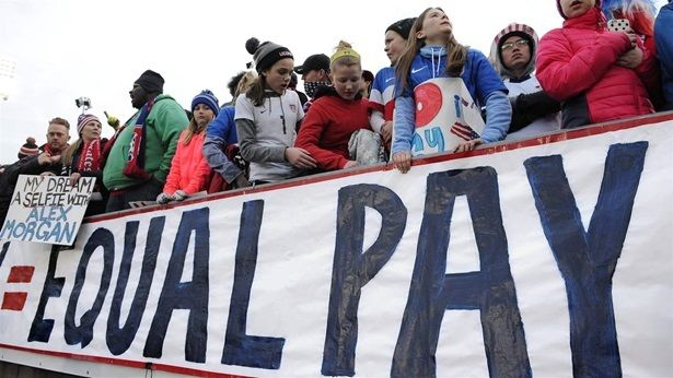<p>Fans protest for higher wages for the U.S. women's soccer players at a match against Colombia in East Hartford, Connecticut. The women's team has won three World Cups but its players are paid significantly less than the U.S. men. To help close the gender pay gap, some cities and states are barring employers from asking new hires about their current salary.</p>