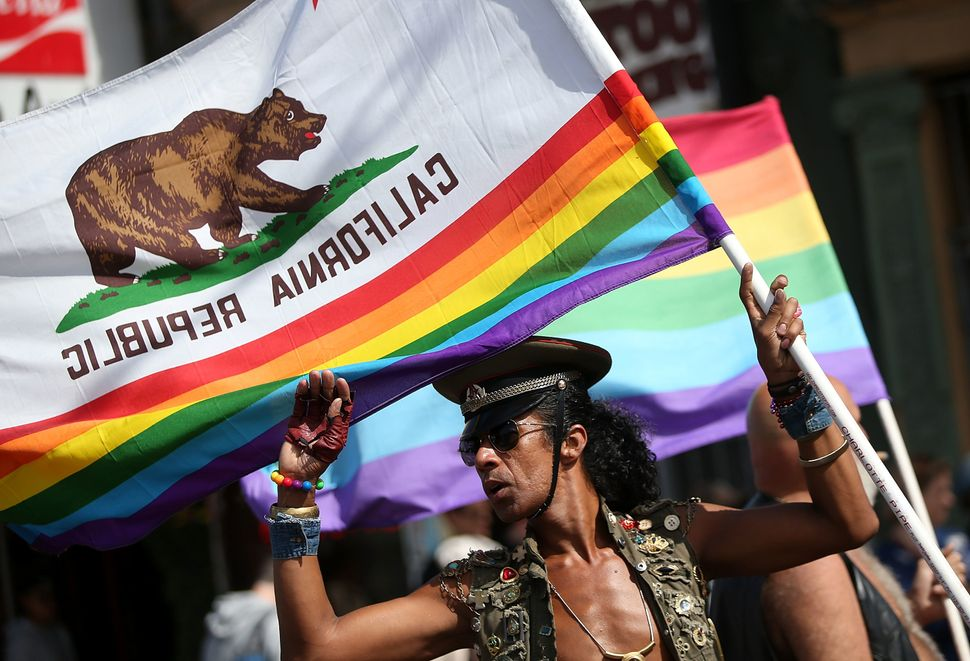 A celebrant in San Francisco combined gay pride colors with the California state flag.