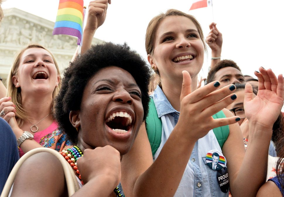 Joy was etched on the faces of those applauding the marriage ruling outside the Supreme Court building.