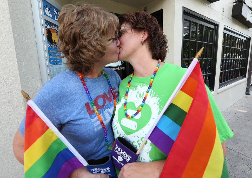 Patty Duffy (left) and wife Lusinda Duffy kissed in Orlando, Florida. Like California, Florida was among several states that