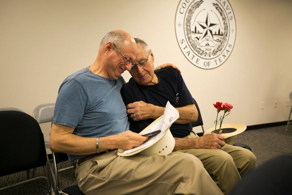Jeff Sralla (left) with his partner, Gerard Gafford, shared a moment at the Travis County Clerk's office in Texas where they