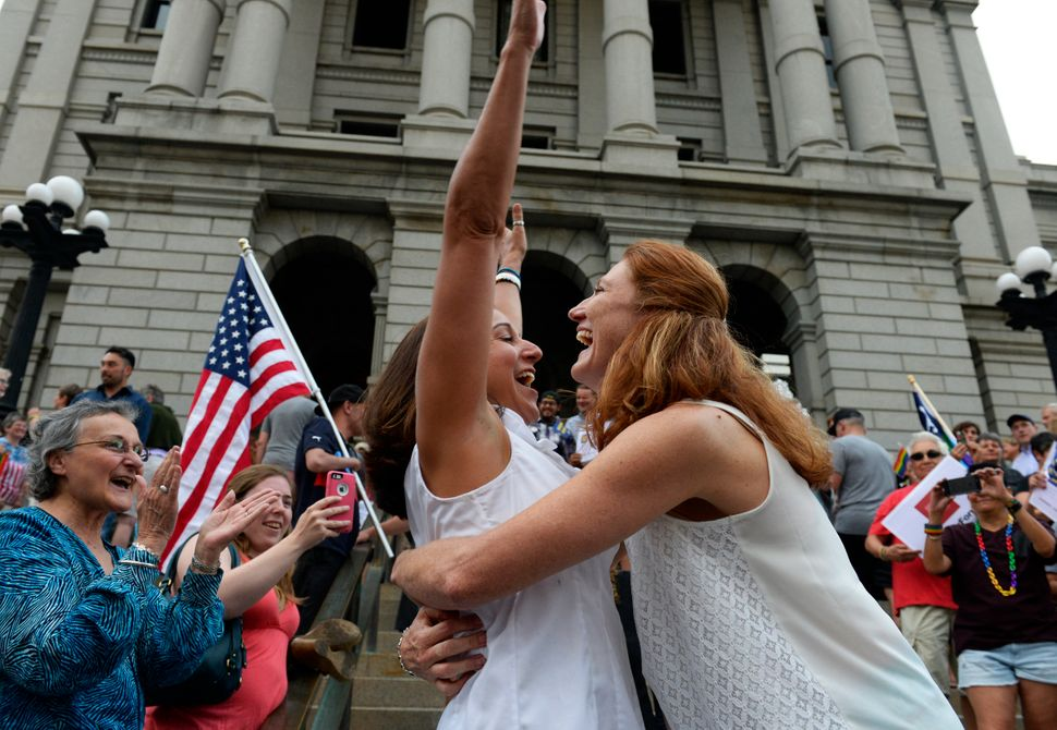 Stephanie Santorico (left) and Diane Santorico got married during a rally celebrating the ruling outside the Colorado state C