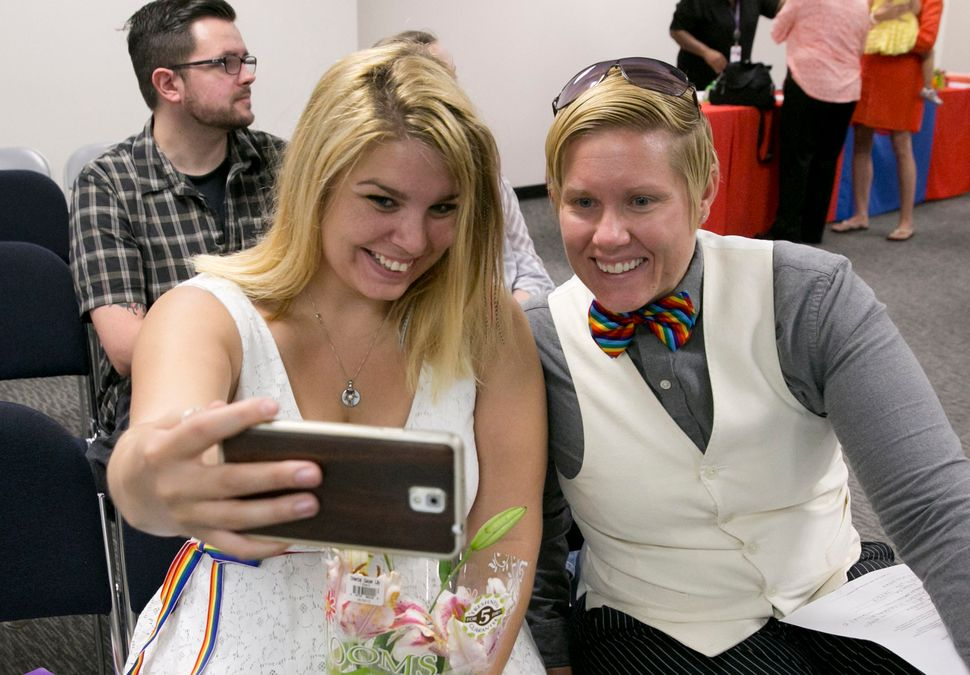 Chelsea Henderson (left) and Amanda Wallace, took a selfie as they waited to obtain their marriage license at the Travis Coun