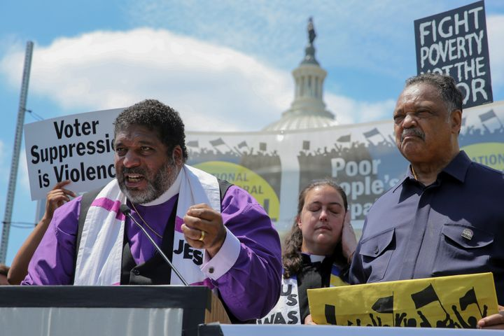 From left: The Rev. Wiliam Barber, the Rev. Liz Theoharis and the Rev. Jesse Jackson at a Poor People's Campaign rally